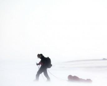 a man with a slide, walking in a snow storm, Death from Hypothermia - A Past Life Memory