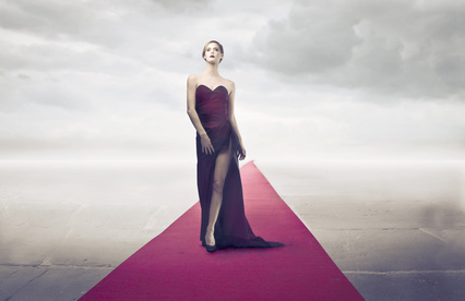 woman on the red carpet, symbolizing fame and immortality, representing her desire for fame