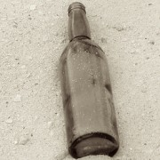 Empty bottle symbolizing children with past lives as alcoholic
