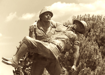 soldier carrying a wounded soldier in one of the world wars, clearing your child's past life trauma