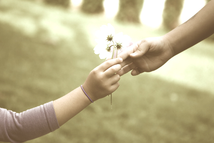 child gives a flower to a woman, Kindness to Others